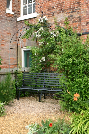 A metal arbour with a rambling rose