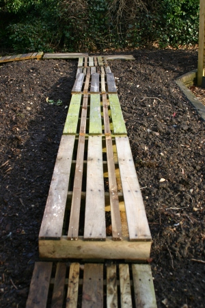 New boardwalk made of old wooden pallets