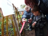 Local children cutting the ribbon on the 'Curiosity Corner'