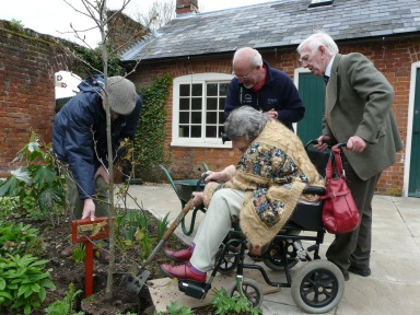 Mary and Derek Manning plant a tree to mark the opening of the garden