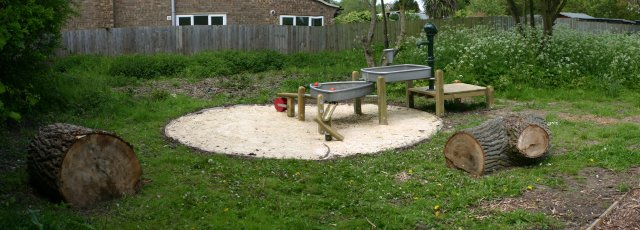 A sand and water play feature aimed at younger children
