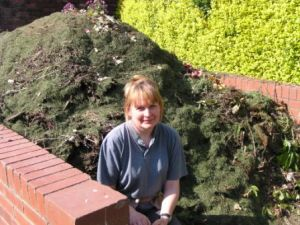 Gardener in charge Allison Napier- normally not sitting on the compost, but turnning it!