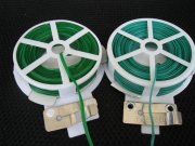 Plastic/wire twist on reel- can cut to length required and easy to use , but once fixed doesn't have much give, so not good where stems growth expected as it will effectively cut the stem unless loosened in time.
