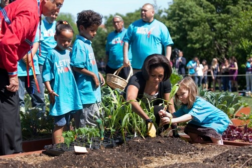 First Lady and 3 sisters - Michelle Obama showing American children how to plant