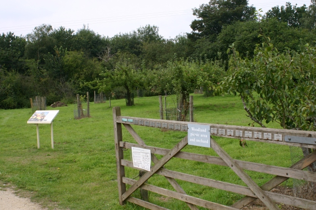 Gate to the Orchard showing plaques recording different varieties of donated Norfolk apple trees