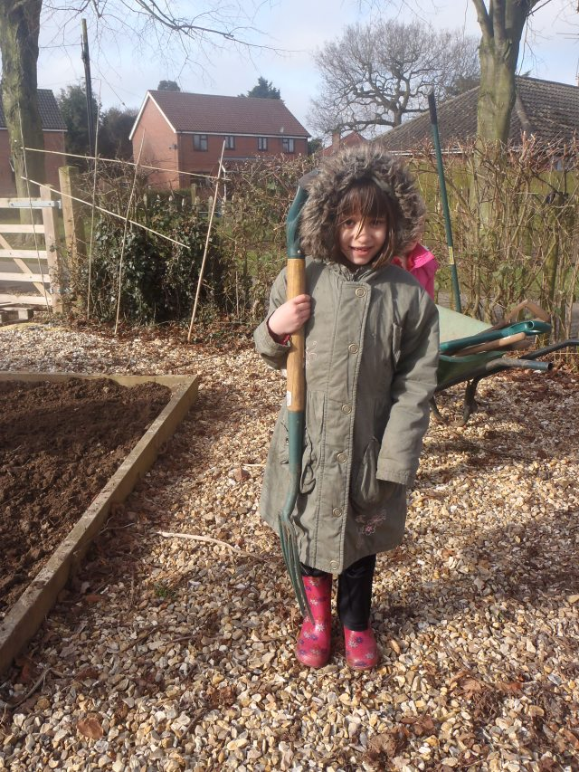 Basic gardening skills, like how to carry tools safely, are an essential part of the curriculum