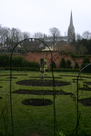 The rose garden and church beyond