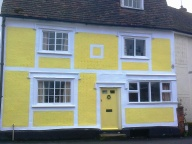 Brightly painted, pargetted cottage in the town centre
