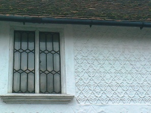Pargetting and metal windows simialr to the originals on the Old School!