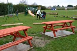 Toddler area with picnic benches