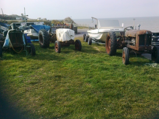 Old time tractors used for pulling the boats up the slipway, Overstrand