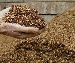 Wood chip mulch (as long as it's at leas ta year old) can be a good mulch to add around planst to conserve moisture and add goodness