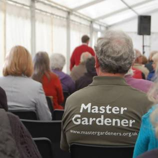 Master Gardener- reverse view (not me, much too much hair)