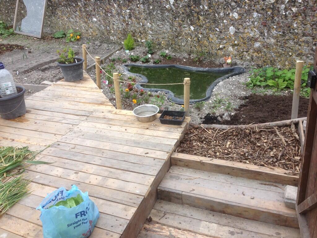 Even more pallet power old school garden for Garden decking from pallets