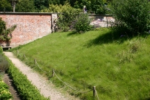 A grassed over sloping bed