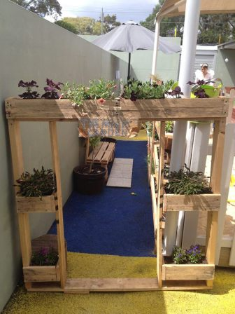 Planter entrance to a play area from pallets