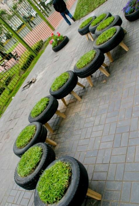 A neat row of tyre containers- herbs? grass-lined seats?