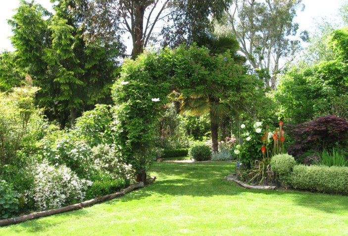 A large garden can be broken up into a series of more interesting spaces using arches, hedges, screens etc.