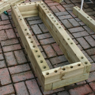 Two layers in place, the planter starts to take shape