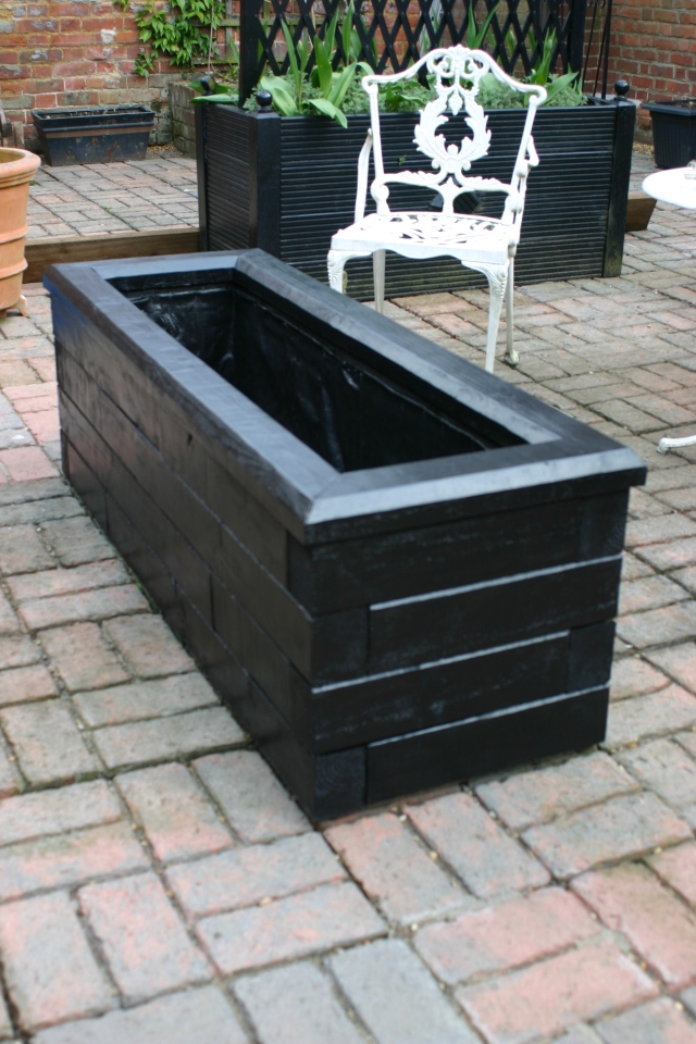 The planter painted and lined, ready to fill.