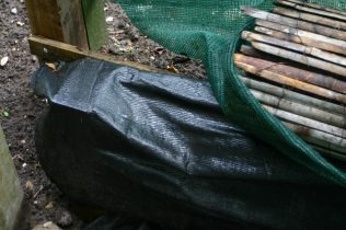 Detail of the retaining wall made of pallets cut in half and 'wrapped' in landscaping fabric