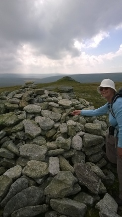 Adding a stone to the cairn at High Willhays