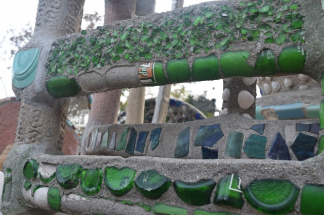 Mosaic with glass bottles.