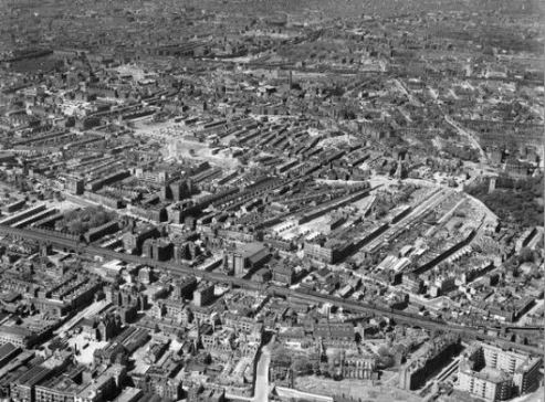 An aerial view of Shadwell and Stepney from the south-east in 1946.  John Scurr House can be seen in the bottom right-hand corner. EAW000637 Britain from Above © English Heritage