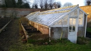 The smaller glasshouse which will, for now, be retained as it is