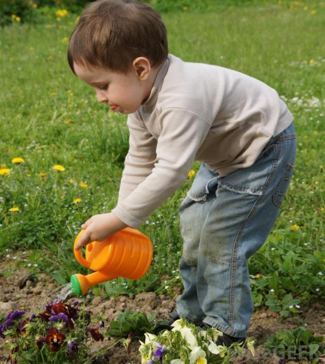 child-watering-the-garden