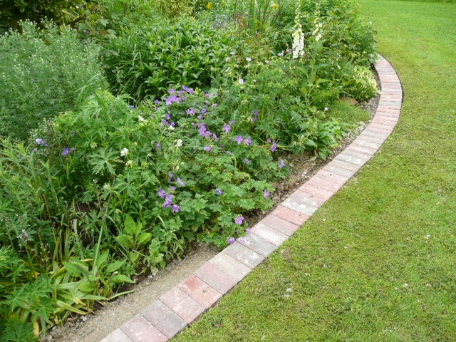 A mowing strip using block pavers