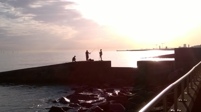 Fishermen on a groyne at Rottingdean, Sussex recently...