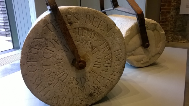 Carved lawn rollers by sculptor Eric Gill, at Ditchling Arts and Crafts Museum, Sussex