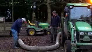 Ed and Peter using the powerful 'vacuum cleaner' attachment to the tractor to suck up and shred the colleced foliage
