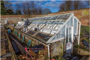 Now you see it...Darren from DS Builders begins work on dismantling the second greenhouse...