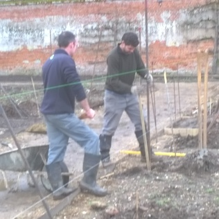 Mike and Rob soldier on with the metal posts