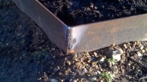 Some of Peter's welding work, to provide strong corners to the metal path edging