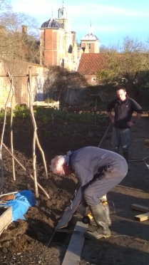 Peter cutting some edging to length with Mike looking on
