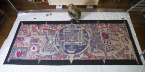 Conservationists at The National Trust's Castle Drogo, Devon hanging a vibrant tapestry by artist Grayson Perry, created for his popular Tomb of the Unknown Craftsman exhibition at The British Museum, is set to be displayed at Castle Drogo which is on loan from a private collector.
