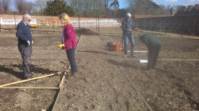 Garden Design course participants getting to grips with a setting out exercise in the Walled Garden at Blickling