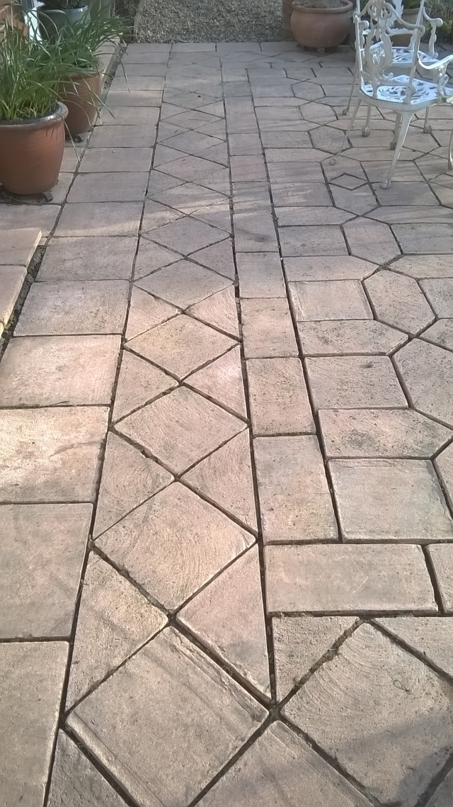 Getting cleaner- the terrace after it's first pressure wash