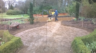 Whacking down the path base- this will have gravel laid over...