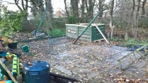 Repositioned compost bins and the slab base for the new shed